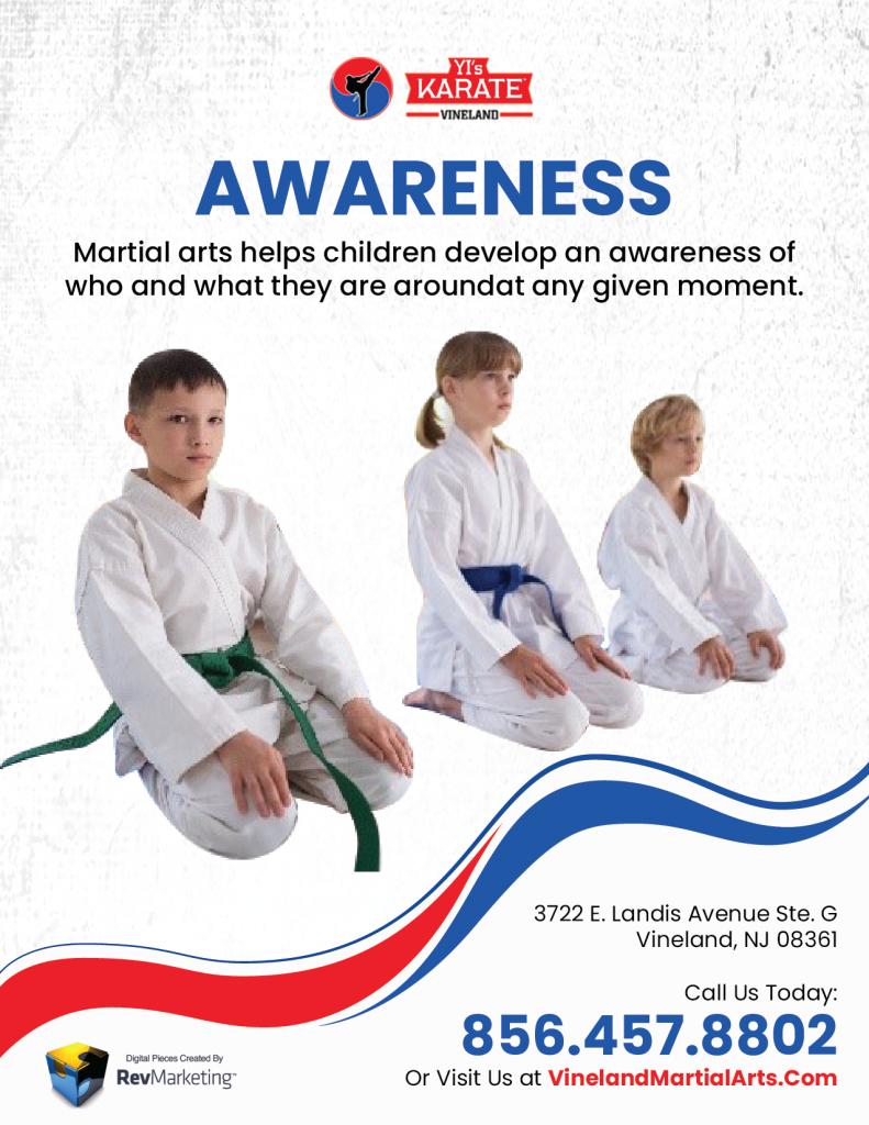 Three Martial Arts Student Kneeling